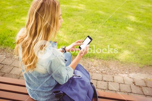 High angle view of woman using smartphone at park