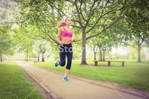 Sporty woman running in park