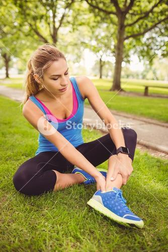 Jogger woman holding legs