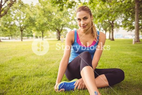 Portrait of smiling woman with legs crossed