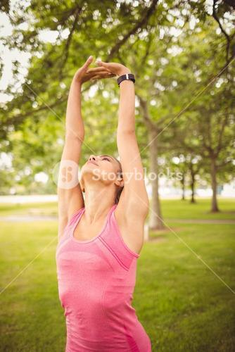Woman exercising with arms raised