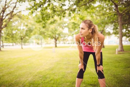 Woman holding knees in park