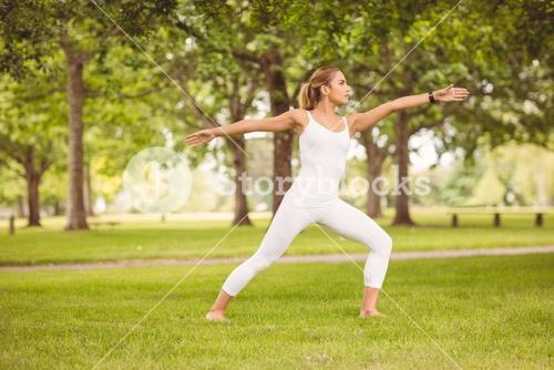 Woman exercising with arms outstretched