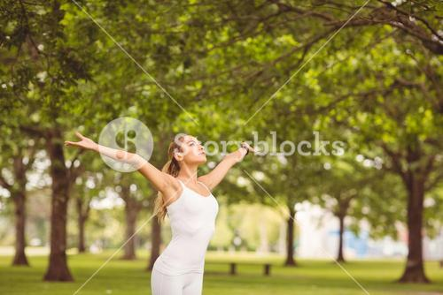 woman with arms outstretched