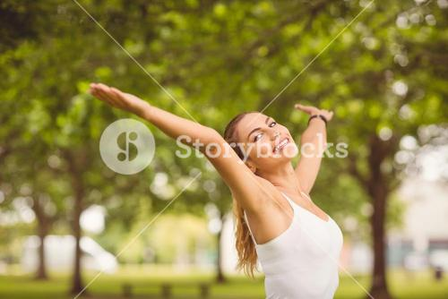Portrait of smiling woman with arms outstretched