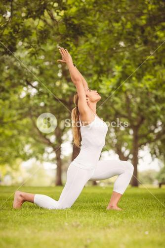 Woman stretching body with hands raised