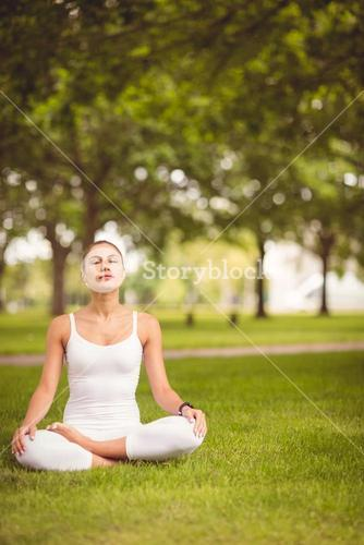Woman sitting in lotus pose