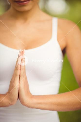 Woman with hands clasped
