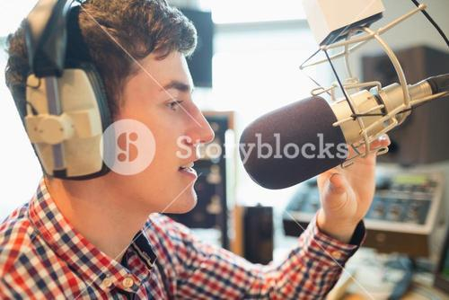 Young radio host broadcasting in studio