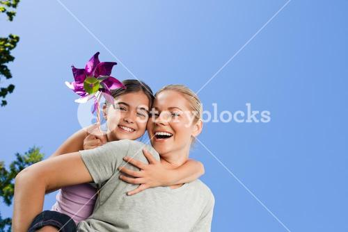 Mother and her daughter with a windmill
