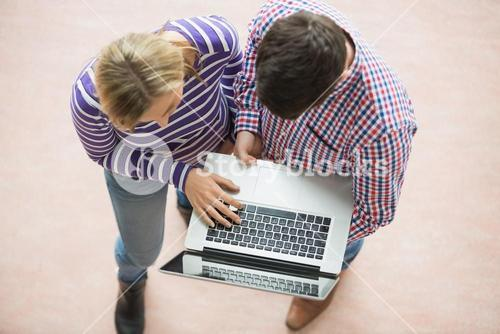 College students working on laptop