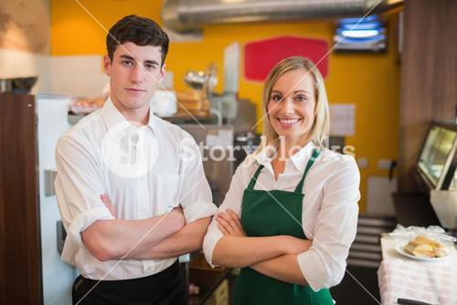 Happy confident coworkers in bakery