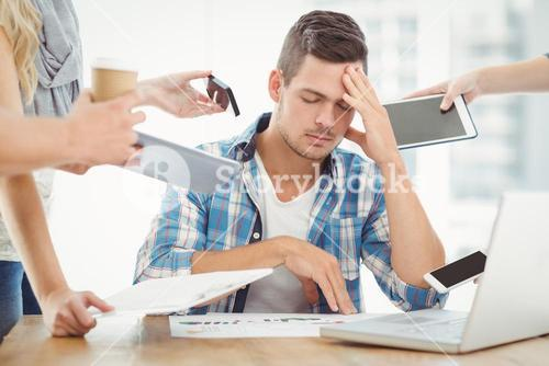 Depressed businessman with head in hand