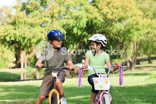 Brother and sister with their bikes during the summer