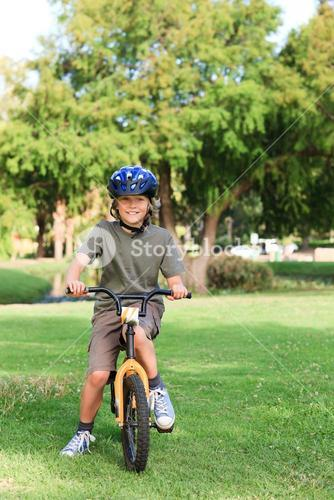 Little boy with his bike in a park