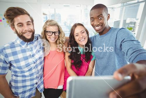 Smiling business people making face for selfie