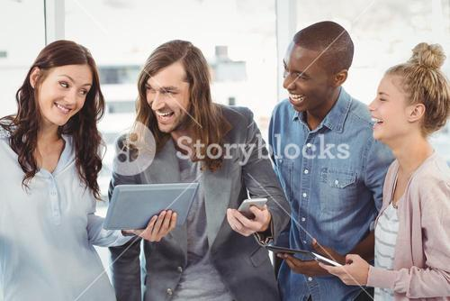 Happy business team using technology