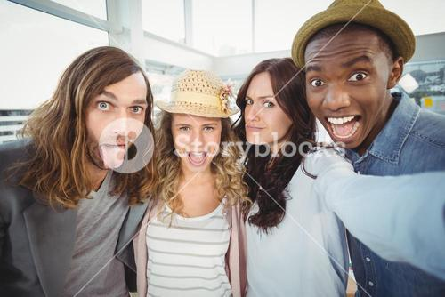 Business team making face while taking self portrait