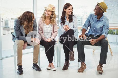 Smiling business people sitting on chair