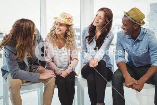 Happy business people sitting on chair