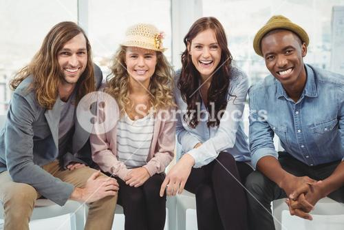 Portrait of smiling business people sitting on chair