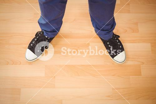 Man standing on hardwood floor