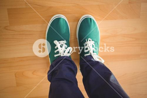 Creative businessman standing on hardwood floor
