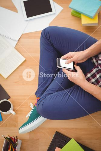 Hipster using smartphone in office