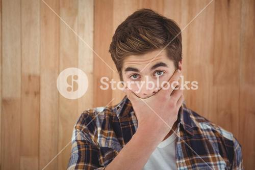 Portrait of hipster covering mouth