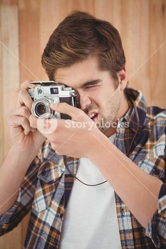 Close-up of hipster photographing