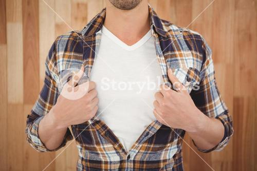 Mid section of hipster opening shirt in superhero style