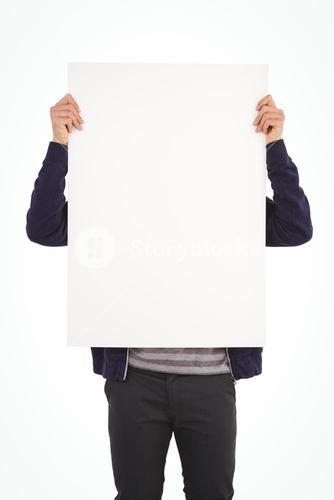Man showing billboard in front of face