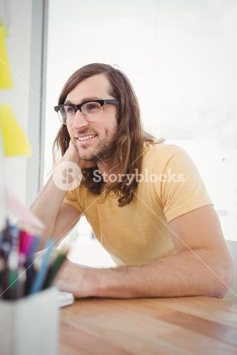 Hipster wearing eye glasses working at desk