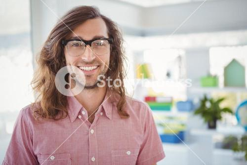 Happy hipster wearing eye glasses