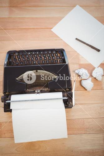 Typewriter and papers at desk in office