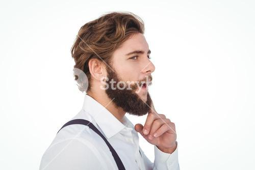 Thoughtful hipster with finger on chin