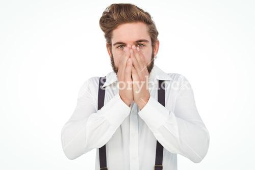 Portrait of hipster with hands covering mouth
