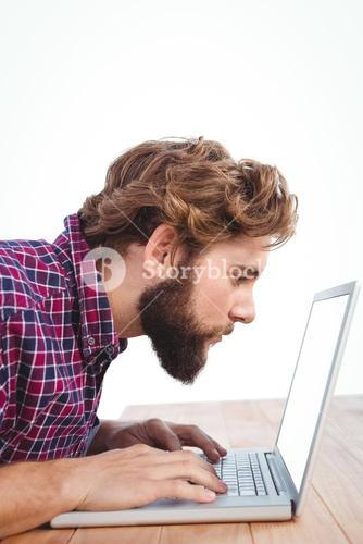 Concentrated man working on laptop