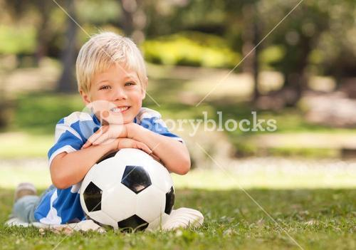 Boy with his ball during the summer
