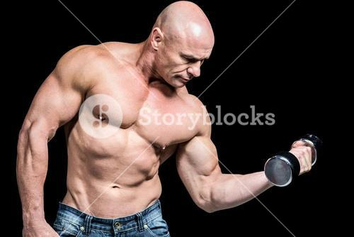 Bald man lifting dumbbells