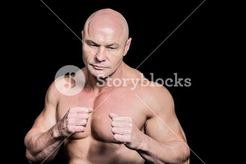 Bald man in boxing pose