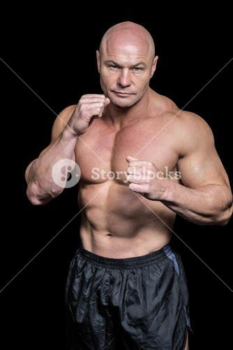 Portrait of bald man with boxing pose