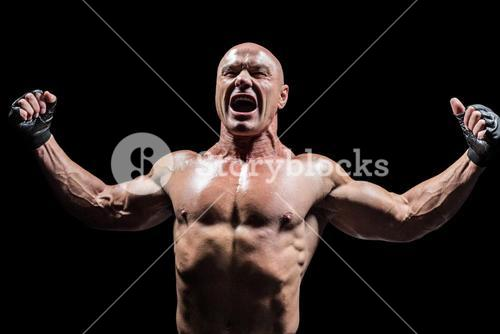 Angry fighter with arms outstretched