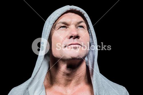 Athlete in hood looking up
