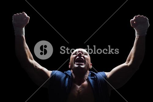 Winner fighter with arms outstretched