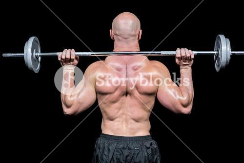 Rear view of bodybuilder lifting crossfit