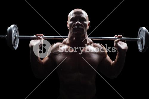 Portrait of bald man lifting