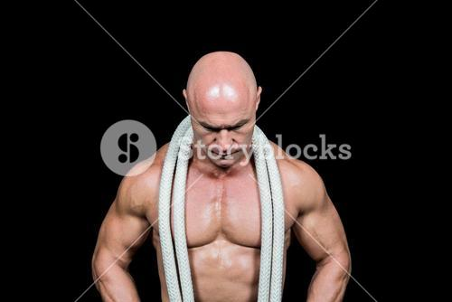 Bald man with rope around neck