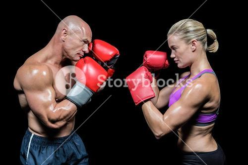 Side view of boxers with fighting stance