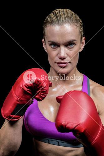 Portrait of female boxer with gloves